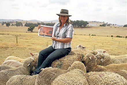 2013 NSW-ACT RIRDC Rural Women's Award finalist Vivien Thomson, Muttama, with a draft of her soon to be published book 'Ashes of the Firefighters', and poddy lambs and ewes. Photo Courtesy of The Land