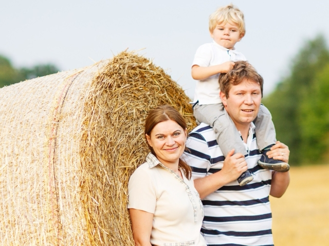 family on hay bail shutterstock_175723934