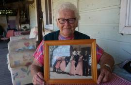 Merriwa's Eva Towler holding her wedding photo in February 2018, after celebrating her 60th wedding anniversary with partner Mick Towler.