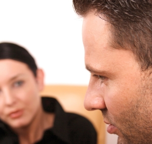 Man speaking with a woman